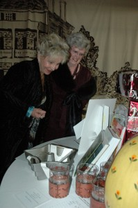 ladies inspecting the prizes at the tannenbaum ball