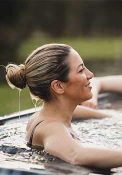Woman enjoying outdoor hottub